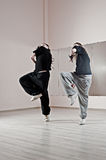 Two girls dancing synchronously Royalty Free Stock Photography