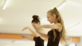 Two girls are dancing stock footage
