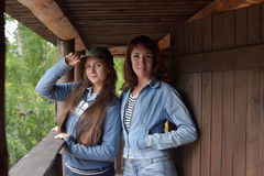 Two girls in denim jacket stock photos