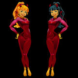 Two girls devils in red latex on black background Stock Photos