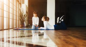 Two girls of different ages makeing yoga Royalty Free Stock Image