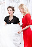 Two girls discuss the dress Stock Images