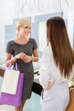 Two girls discuss purchases Royalty Free Stock Photo