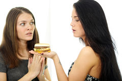 Two girls divide one sandwich Stock Photo