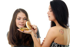 Two girls divide one sandwich Royalty Free Stock Photo