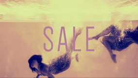 Two girls diving into swimming pool in evening dresses with sale text stock footage
