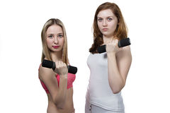Two girls do fitness Royalty Free Stock Photo