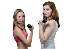 Two girls do fitness Royalty Free Stock Photography