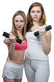 Two girls do fitness Royalty Free Stock Photos