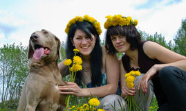 Two girls and dog Stock Photos