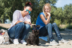 Two girls with dog Stock Photo
