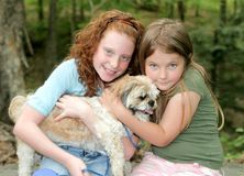 Two girls and a dog Stock Photo