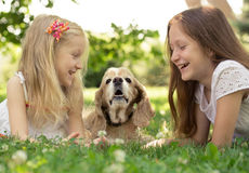 Two girls with dog Stock Images