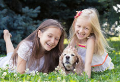 Two girls with dog Royalty Free Stock Photo