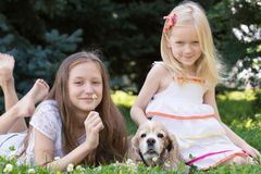 Two girls with dog Royalty Free Stock Image