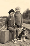 Two girls and a dog go by rail Stock Photos