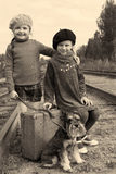 Two girls and a dog go by rail Royalty Free Stock Photo