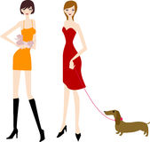 Two girls with the dogs Royalty Free Stock Image