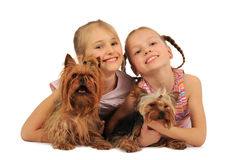 Two girls with dogs Stock Photos