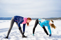 Two girls doing aerobics exercises Royalty Free Stock Photography