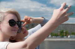 Two girls doing selfie Royalty Free Stock Images