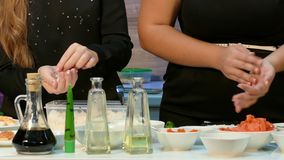 Two girls doing sushi in the kitchen stock video footage