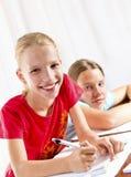 Two girls doing their homework Royalty Free Stock Photo