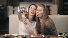 Two girls doing various selfie in the restaurant. stock video footage