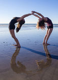 Two girls doing yoga Stock Images