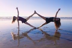 Two girls doing yoga Stock Photo
