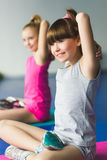 Two girls doing yoga stretching in fitness class Stock Images