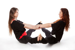 Two girls doing yoga Stock Photos