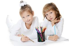 Two girls draw color pencils isolated on white Royalty Free Stock Image