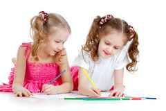 Two girls drawing with color pencils Royalty Free Stock Photo