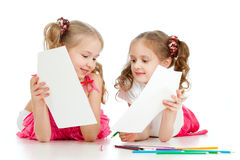 Two girls drawing with color pencils Royalty Free Stock Photography