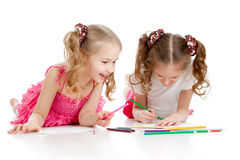 Two girls drawing with color pencils together Royalty Free Stock Images