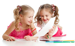 Two girls drawing with color pencils together Royalty Free Stock Photography