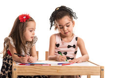 Two girls drawing Royalty Free Stock Photos