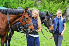 Two  girls - dressage riders with horses Royalty Free Stock Image