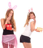 Two girls dressed as a rabbit with gifts. Studio shooting Stock Photography
