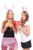 Two girls dressed as a rabbit with gifts. Studio shooting Stock Photos