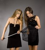 Two girls in dresses with butterfly net Royalty Free Stock Photos