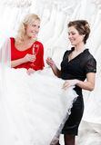 Two girls drink champagne Stock Images