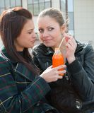 Two girls drink juice Royalty Free Stock Photos