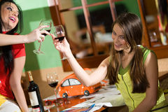 Two girls drink wine Royalty Free Stock Images