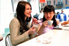Two girls drinking cappuccino Stock Photography