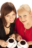 Two girls drinking coffee Stock Images