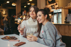 Two girls drinking coffee in cafe Royalty Free Stock Image