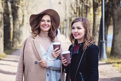 Two Girls Drinking Coffee and Chatting Stock Image
