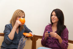 Two Girls Drinking Coffee Royalty Free Stock Photos